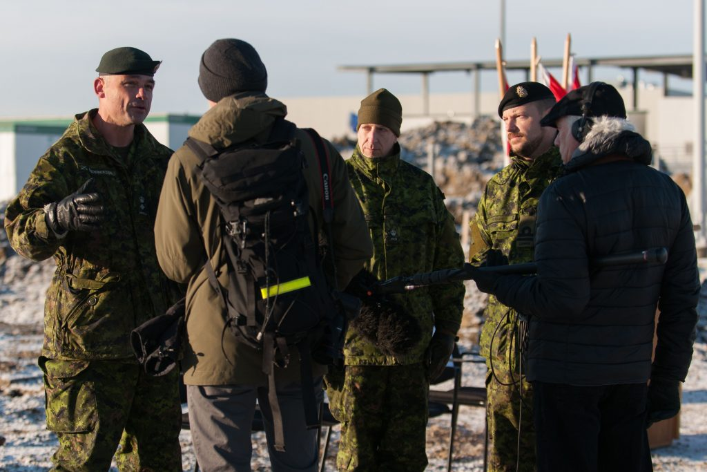Lieutenant Colonel Corey Frederickson, Chief of Operations Services Branch 3rd Canadian Division Support Group, being interviewed by reporters at the construction site for the new Tactical Armoured Patrol Vehicle (TAPV) facility in the 3rd Canadian Division Support Base Edmonton, Alberta on December 2, 2016. The Tactical Armoured Patrol Vehicle (TAPV) is a wheeled combat vehicle that can fulfill a variety of roles on the battlefield, such as reconnaissance and surveillance, security, command and control, cargo and armoured transport of personnel and equipment. The TAPV replaces the Armoured Patrol Vehicle (RG-31), a portion of the Coyote reconnaissance vehicle (LAV 2) and will complement the Light Utility Vehicle Wheeled (G-Wagon). Photo By: Master Corporal Andrew Davis, Imagery Technician, 3rd Canadian Division Support Base Edmonton © DND-MDN 2016 EN2016-0196-006